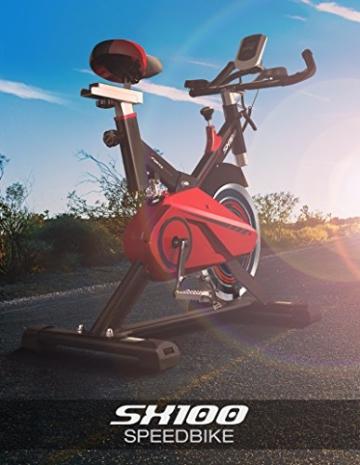 Sportstech Profi Indoor Cycle SX100 mit 13KG Schwungrad, Gepolsterter Armauflage, Komfortsattel, Pulsmessung – Speedbike mit flüsterleisem Riemenantrieb – Bodenschutzmatte gratis -